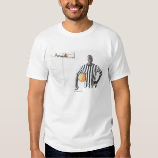 Referee holding basketball on court t-shirts