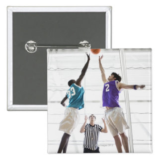 Referee watching basketball players jumping 15 cm square badge