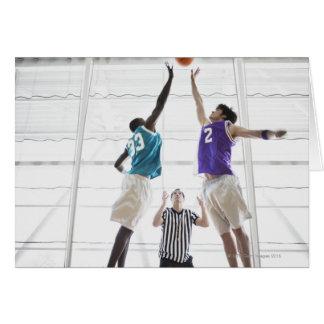 Referee watching basketball players jumping greeting card
