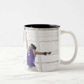 Referee watching basketball players jumping coffee mugs