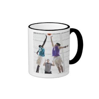 Referee watching basketball players jumping ringer mug