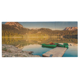 Reflection in water of mountain lakes and boats wood USB flash drive