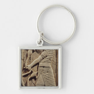Relief depicting a warrior key ring