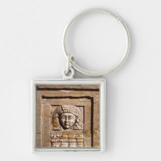 Relief depicting a woman at a window key ring