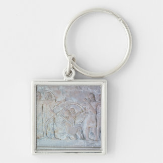 Relief depicting archers key ring