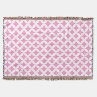 Repeat circle quarters style pink pattern throw