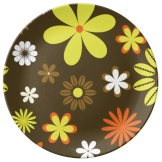 Retro yellow and orange flowers on brown porcelain plates