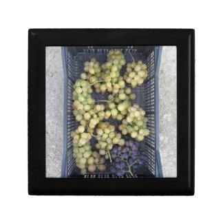 Ripe grapes in box