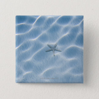 Rippled blue water with starfish 15 cm square badge