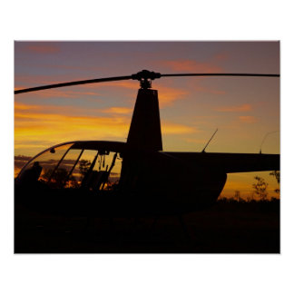 Robinson R44 helicopter at sunset Poster