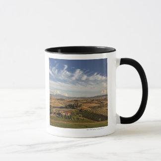 Rolling farm land after the harvest at sunset mug