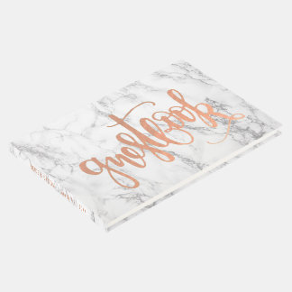 Rose gold calligraphy on marble guest book