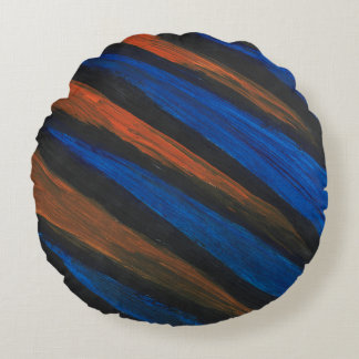 Round Pillow that is Black, Blue, and Orange.