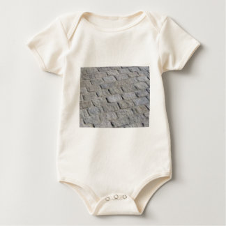 rows of stone baby bodysuit
