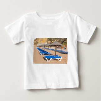 Rows of wicker parasols and beach beds.JPG Baby T-Shirt