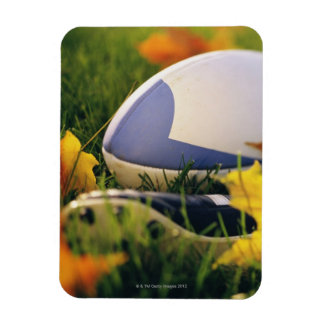 Rugby ball and shoe on lawn in autumn rectangular photo magnet