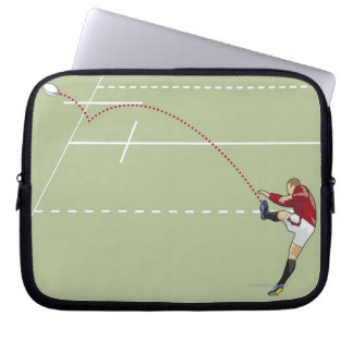 Rugby player kicking ball into touch, dotted laptop sleeve