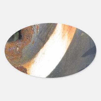 rustedmetalcircle.jpg oval sticker