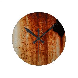 Rusty distressed artistic grunge background round clock