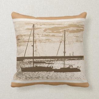 Sail boats on shore at dusk cushion