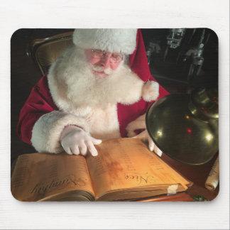 Santa Looking at Naughty and Nice List Mouse Pad