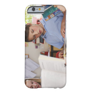 schoolgirl concentrating on reading in class barely there iPhone 6 case