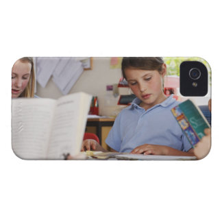 schoolgirl concentrating on reading in class iPhone 4 cover