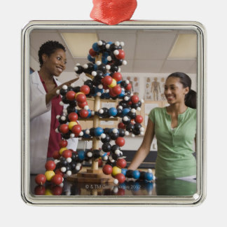 Science teacher and teenage girl looking at christmas ornaments