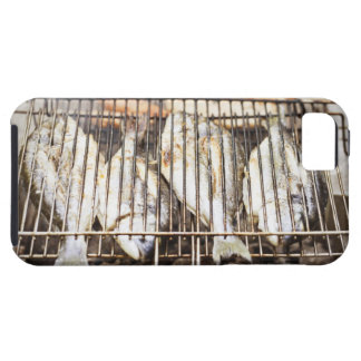 Sea breams on barbecue grill. case for the iPhone 5