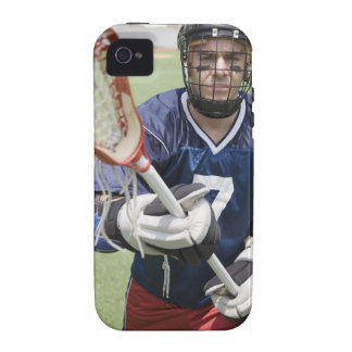 Serious lacrosse player holding crosse case for the iPhone 4