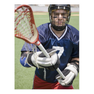 Serious lacrosse player holding crosse postcard