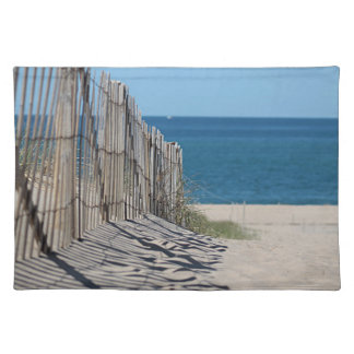 Shadows in the sand, beach fence and ocean beach placemat