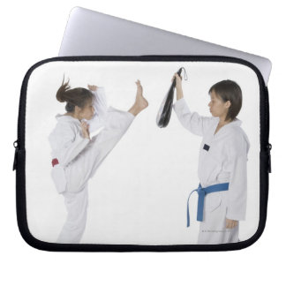 Side profile of two young women practicing laptop sleeve