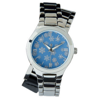 Silver snowflakes on a cobalt blue background watch