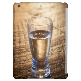 Single shot of Tequila on wood table