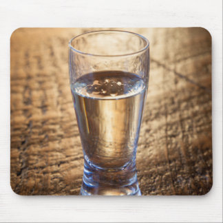 Single shot of Tequila on wood table Mouse Pad