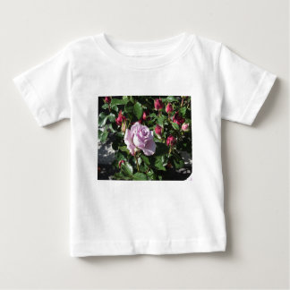 Single violet rose flower with red roses around baby T-Shirt