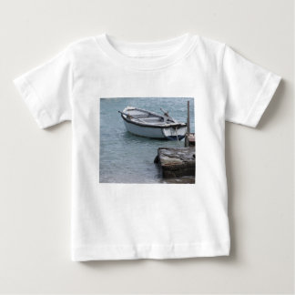 Single wooden rowing boat moored in a harbor baby T-Shirt