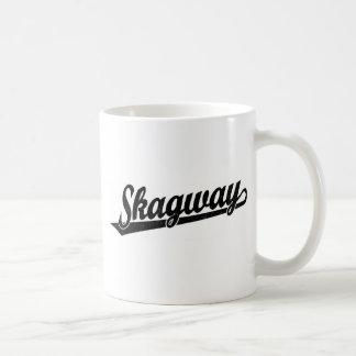 Skagway script logo in black distressed coffee mug