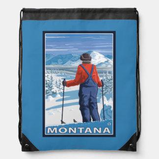 Skier AdmiringMontanaVintage Travel Poster Drawstring Bag