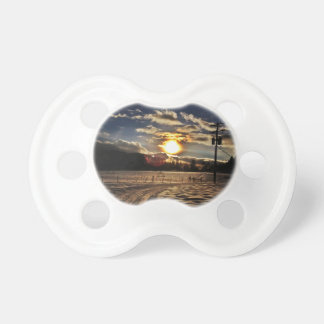 skiing at sunset pacifiers