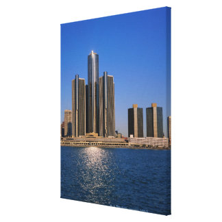 Skyscrapers by the water in Detroit Canvas Print