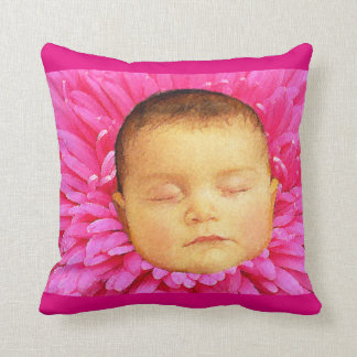 Sleeping baby on a flower throw pillow. cushion