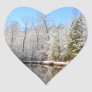Snow covered landscape around the pond heart sticker
