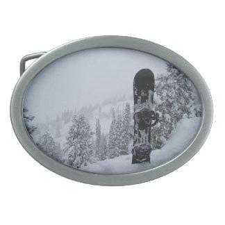 Snowboard In Snow Oval Belt Buckle