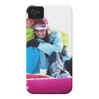 Snowboarder couple sitting on snow iPhone 4 Case-Mate cases
