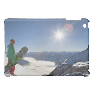 Snowboarder looking from mountain top iPad mini cases