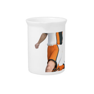 Soccer Player in Orange,Black,and White Pitchers