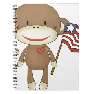 Sock monkey with flag notebook