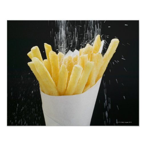 Sprinkling salt on chips in paper cone poster